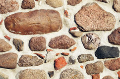 Medieval wall background. Texture background of a medieval wall of stones and bricks pieces Stock Image