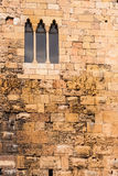 The medieval wall of the building. It is in the old wall. Weathered brick structure. Stone wall. Tarragona, Spain Royalty Free Stock Photos