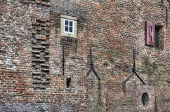 Medieval wall with cramps and windows Stock Photo