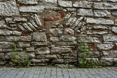 Medieval wall. Fortification wall of the old brick in the ancient town Stock Photography