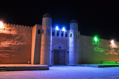 Medieval wall with a gate in the light colored lights Royalty Free Stock Photos
