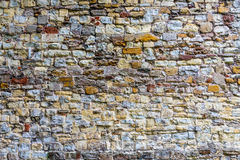 Medieval wall. Old wall has become a multicolored wall Stock Photos