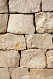 Medieval wall of stone blocks Stock Photos