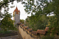 Medieval Wall and Tower Rothenburg Germany. In Rothenburg Germany, a view of the medieval town wall and tower Royalty Free Stock Images