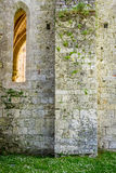 Medieval wall of white stone with a high window Royalty Free Stock Image