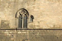 Medieval wall with window. Barcelona Royalty Free Stock Images