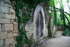 Medieval wall with wooden doors Royalty Free Stock Photos