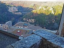 The walls of Pitigliano, Italy and Tuscany countryside stock photography