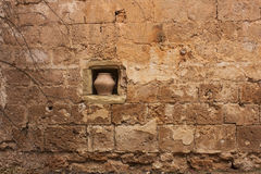 Medieval walls of the Cathedral with a pot of water. Spàin Stock Image