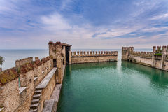 Medieval walls and Lake Garda. Royalty Free Stock Photo