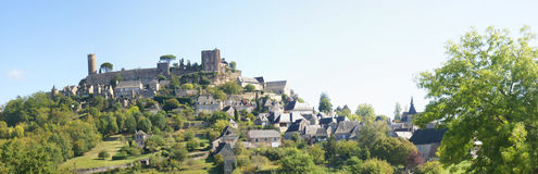 Medieval walls and towers at the top of a hil Royalty Free Stock Image