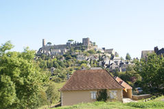 Medieval walls and towers at the top of a hil Stock Photo