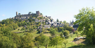 Medieval walls and towers at the top of a hill Stock Photos