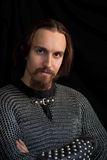 Medieval warrior. With beard in chain armour over black background Royalty Free Stock Photos