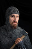 Medieval warrior. With beard in chain armour over black background with hacket Royalty Free Stock Photos