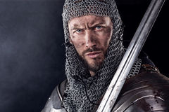 Medieval Warrior with Chain Mail Armour and Sword Royalty Free Stock Images