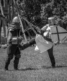 Medieval warrior kick down Royalty Free Stock Photos