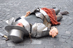 Medieval warrior lying dead Stock Photo