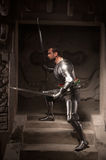 Medieval warrior posing on steps of ancient temple Royalty Free Stock Photos
