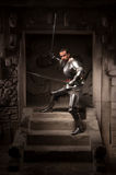Medieval warrior posing on steps of ancient temple stock images