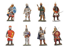 Medieval warriors. Eight tin statues of medieval soldiers over white stock photo