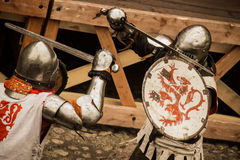 Medieval warriors in iron armor fighting with swords Stock Images
