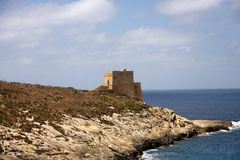 Medieval watch tower on sea bank. Medieval watch tower on Malta's bank Royalty Free Stock Photography