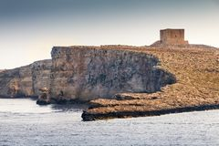 A medieval watchtower built. A medieval watchtower built on a cliff along Malta`s Mediterranean coast Royalty Free Stock Photography