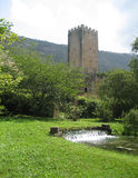 Medieval watchtower and gardens stock images