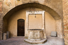 Medieval water well in Tuscany Royalty Free Stock Photo