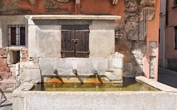 Medieval watering hole in Brescia, Italy. Year 1300. Stock Images