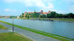 The cityscape of Krakow with Wawel Castle, Poland. Medieval Wawel Castle is located on the bank of Vistula River and surrounded by the lush greenery of the city stock video footage