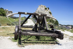 Medieval weapon Catapult. Old wooden medieval catapult at Les Baux de Provence, France royalty free stock images