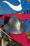 Medieval weapons shield and helmet Stock Photos