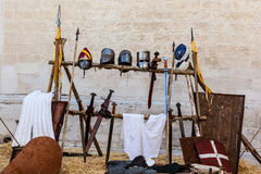 Medieval Weapons. Medieval shields, helm and weapons in a medieval fair in italy Royalty Free Stock Photography