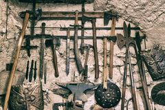 Medieval weapons on a white stone wall. Cool background. stock photography