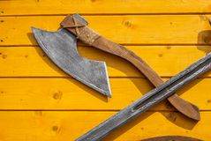Medieval weapons on wooden desk. Royalty Free Stock Photos