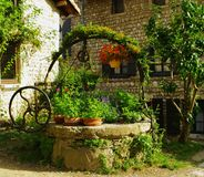 Medieval well in bloom. In perouges in france Royalty Free Stock Photography
