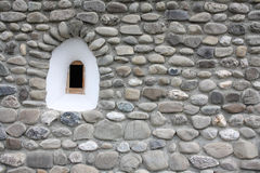 Medieval window. A tiny medieval window on a stone wall Royalty Free Stock Image