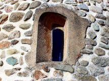 Medieval window of a church. Medieval window on a church wall Stock Photography
