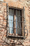 Medieval window with grate Stock Images