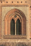 Medieval window with grate Royalty Free Stock Photography