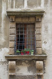 Medieval window with heavy wrought-iron grilles Royalty Free Stock Images