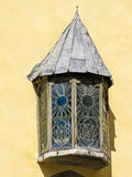 Medieval window with stained-glass, detail of old building in the Old Town Stock Photos