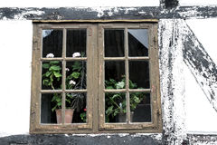 Medieval window in a timbered house Stock Photography