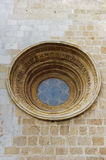 Medieval window and walls of the temple in Tarragona Stock Image