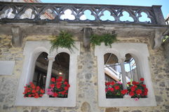 Medieval Windows. These two beautiful windows can be found on a house in the medieval town of Carcassonne in southern France. Even the balcony which is located Royalty Free Stock Photos
