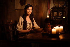 Medieval woman in ancient castle interior.  stock photography