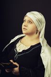 Medieval woman with Bible Royalty Free Stock Photos