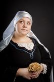 Medieval woman with flower Royalty Free Stock Photos